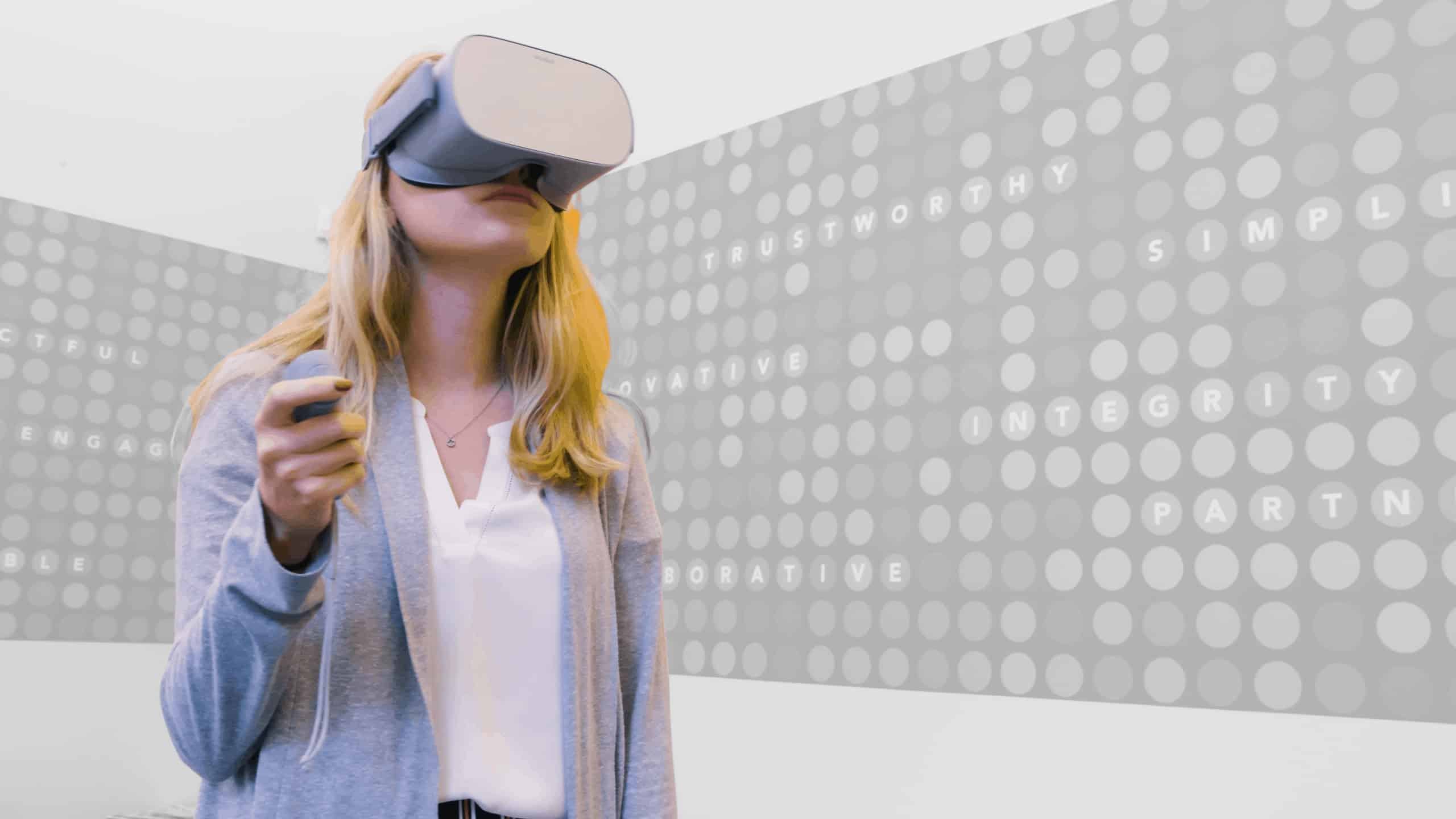 Roundtable Learning employee using VR headset and handset